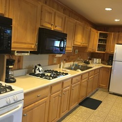 Kitchen has 2 large microwaves, 2 ranges, and 1 oven